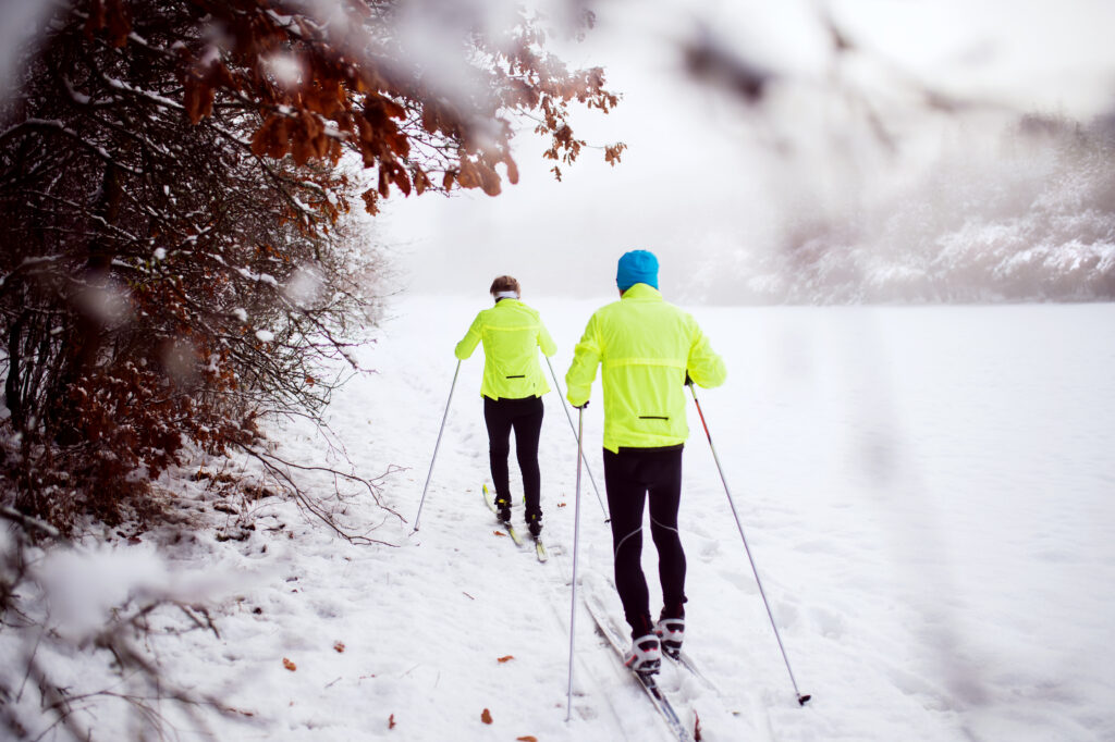 Couple cross-country skiing.
